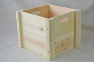 wooden box with hand holes side view