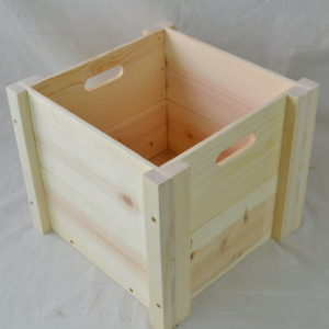 wooden box with hand holes top view