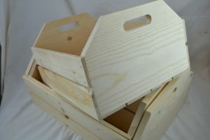 Large 3 piece wooden hand hole nesting crates close up
