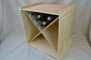wooden wine storage box with bottles