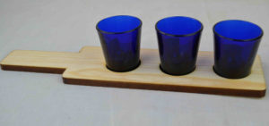 wooden whiskey shot flight with blue glasses